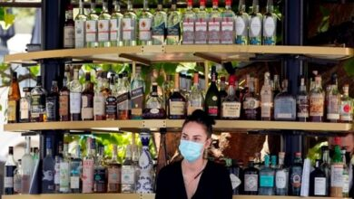 Most vaccinated California workers must keep masks on