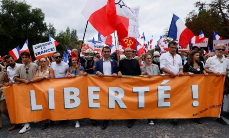 120,000 join French protests against 'health passes'